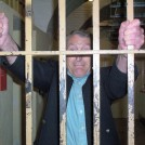 "Photo:Our secretary (Sid) at last where he should be - ""behind bars"""