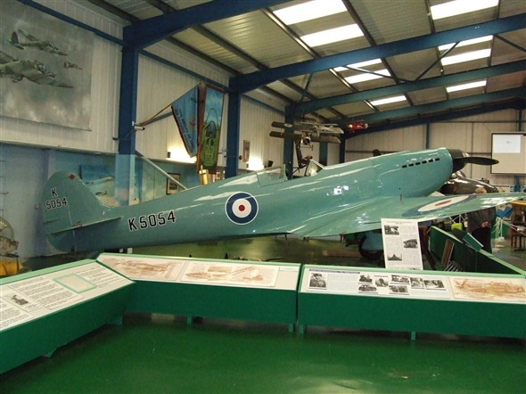 Photo:A tribute to R. A. Mitchell the designer of the Spitfire. A replica of a prototype Spitfire with the development storyline.
