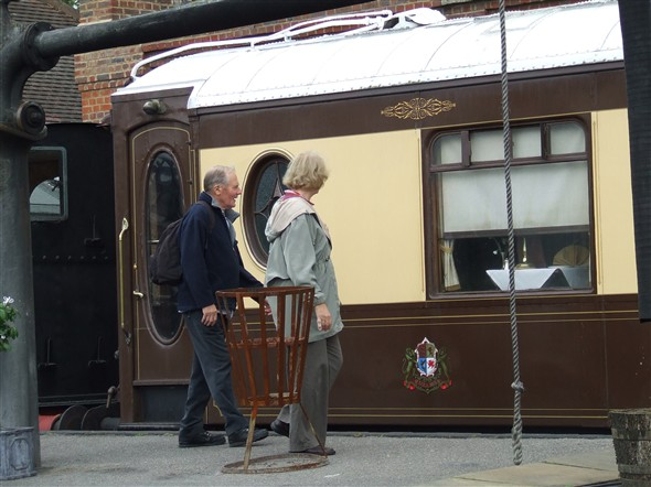 Photo:Bob and Betty admiring one of the Pullman coaches which are used on occasion for lunches and dinners