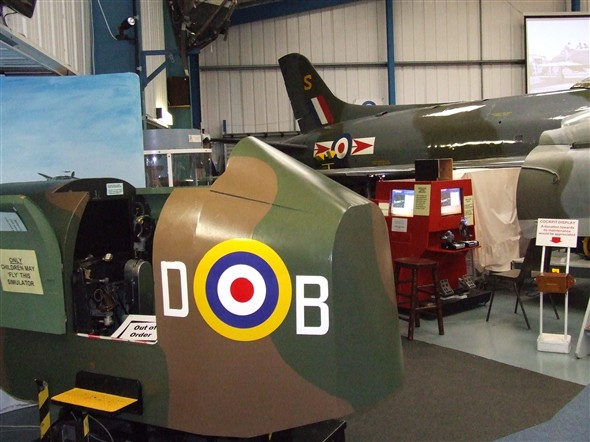 Photo:Two simulators shown here. The one in the foreground is an early type whilst the red one in the background is for those visitors who wish to practice their flying skills