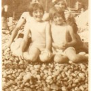 Photo:Me and my sister Sylvia with our parents Charles and Eunice on Banjo beach, Brighton, c1936