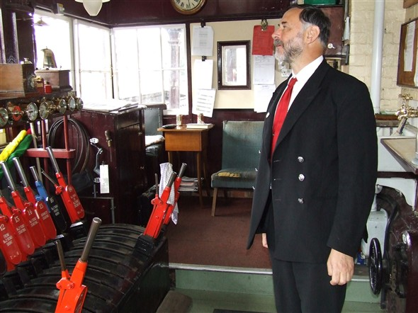 Photo:One of Bluebell Railway's friendly and courtious staff allowing us a peek into the signal box