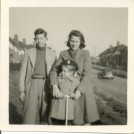 Photo:David Burtenshaw with sisters, Peggy, 4/10/26 & Marion, 11/9/42, outside 29, Manor Rd,Brighton,1945