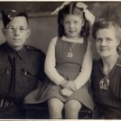 Photo:Mum, Dad and me (10 November 1943).  Dad  - Royal Army Ordnance Corps.