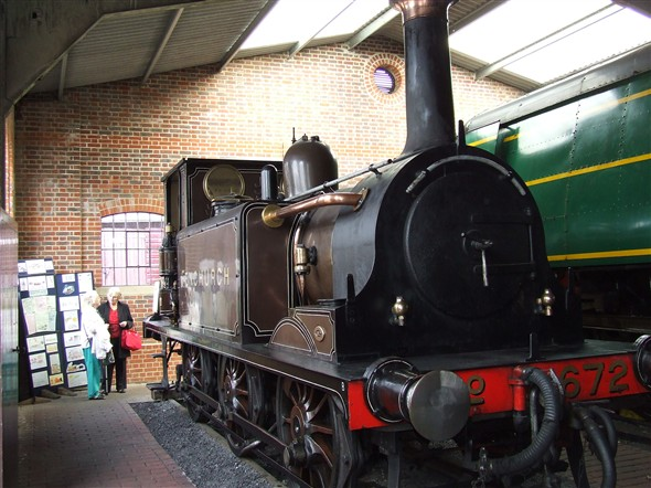 "Photo:Two of our members admiring the Stroudley Terrier ""Fenchurch"" which at one time did shunting work at Brighton"