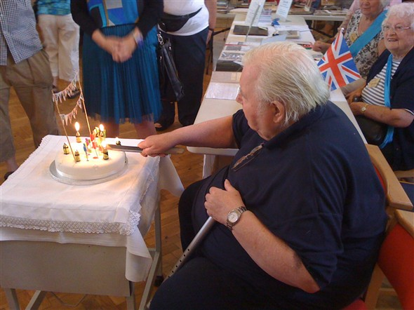 Photo:Fred Netley cutting our anniversary cake.