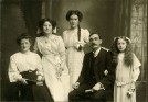 Photo:My grandparents Margaret (nee Buckley) and Albert Woodcock with their children (l-r) Edith, May, and Mary (died 07.03.1934)